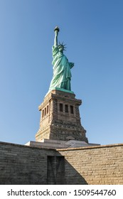 Statue of Liberty with pedestal from bottom to top on a clear blue sky day, New York, USA. The Statue of Liberty Enlightening the World.