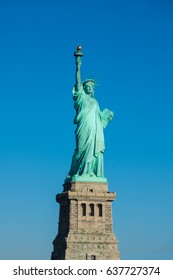 Statue of Liberty at perfect weather conditions blue sky copper