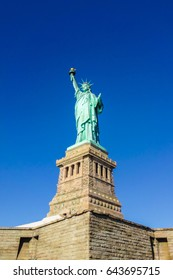 Statue of Liberty at perfect weather conditions blue sky copper torch
