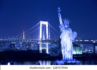 Statue of Liberty and Rainbow Bridge in Odaiba, Tokyo