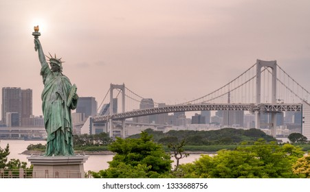 Statue of liberty, rainbow bridge and Tokyo cityscape, Japan