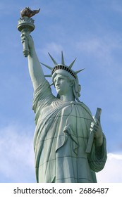the statue of liberty stands tall and mighty