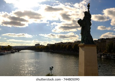 The statue of Liberty and Sunset in Paris, France