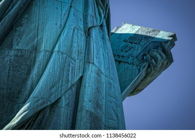The  Statue of Liberty and the tablet held by Lady Liberty.