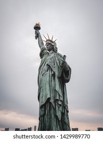 The Statue of Liberty at Tokyo Odaiba with buildings in background