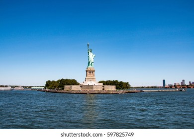 The Statue of Liberty and tourists on Liberty Island, New York City