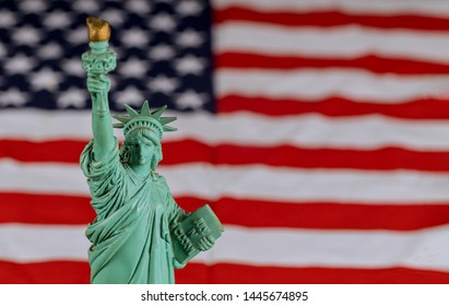 The Statue of Liberty the United States a symbol of freedom and democracy with flag of the United States of America