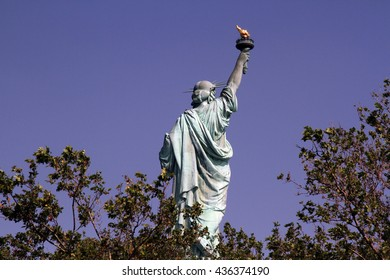 Statue of Liberty as viewed from the back side on the island in New York Harbor