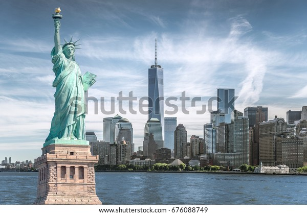 The statue of Liberty with World Trade Center background, Landmarks of New York City