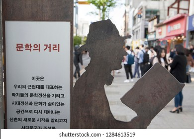 """A statue of the """"Literary street"""" guide at Sinchon Station. seoul,South Korea  2018.04.21"""