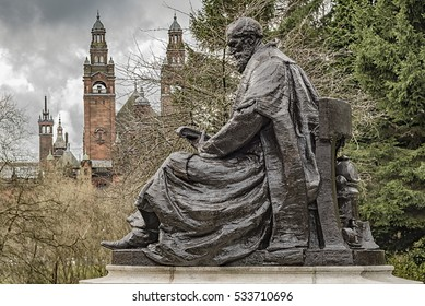 A statue of lord Kelvin situated in Kelvingrove park in the west end of Glasgow with the art gallery and museum in the background.