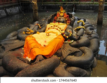 The statue of Lord Vishnu, perched on a pond at Budhanilkantha in Kathmandu, Nepal. This sculpture was build by Vishnu Gupta 1400 years ago. This is sacred place for Hindus where devotees throng here.