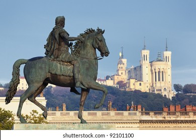 Statue of Louis and Basilique Fourviere on a background