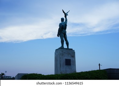 Statue of man and bird