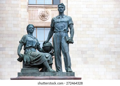 Statue of man and women in front of main building of Lomonosov Moscow State University, Russia