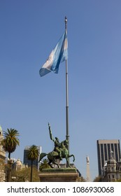 The Statue of Manuel Belgrano on the Plaza de Mayo in Buenos Aires, Argentina. Down, to the bottom on the right, the pyramid of May