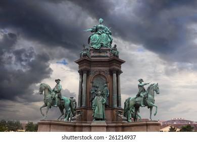 Statue of Maria Teresia over dramatic sky, Vienna, Austria