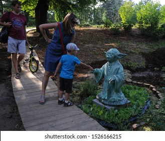 """The statue of the master Yoda of the character of the fantastic saga """"Star Wars"""" on the territory of the Botanical Garden in Kiev. 07/23/2017"""