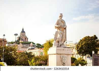 The statue of Messina with church on the background in Sicily, Messina, Italy.
