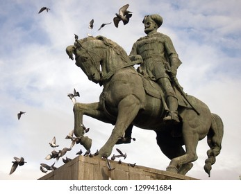 Statue of Mihai Viteazu, a famous romanian ruler, located in Cluj, Romania. A lot of pigeons in flight around the statue