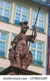 The statue of Minerva in Romerberg Frankfurt German.  the Roman goddess of wisdom and strategic warfare and the sponsor of arts, trade, and strategy. With Spear and Shield in hands