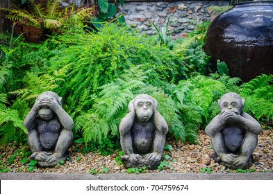 Statue monkey in the garden.Three wise monkeys are close ear, close eyes, close mouth that mean see no evil-hear no evil-speak no evil.