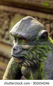 Statue of monkey with green lichen (moss)