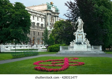 statue of Mozart and Hofburg palace in Vienna, Austria
