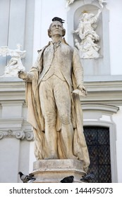 statue of musician Franz Joseph Haydn near The Baroque Church of Mariahilf in Vienna, Austria