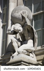 Statue of the mythological Atlas, carrying the globe on his back. Sculpted by the now defunct Farmer & Brindley works, on public display since 1894.   Viewed from public pavement, City of London.