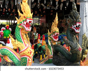 """The statue """"Naga"""" is an animal in Buddhism. The legend is a giant snake. The body is a beautiful green."""