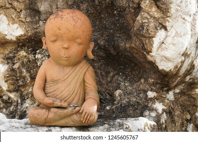statue of neophyte or novice monk