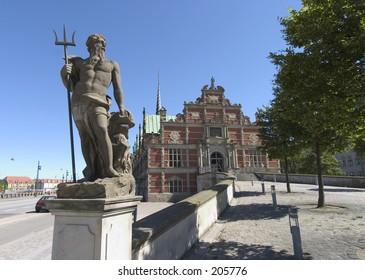 Statue of Neptune in front of former stockexchange in Copenhagen
