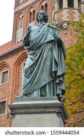 Statue of Nikolai Copernicus on a background the old town hall, 1853. Torun, Poland