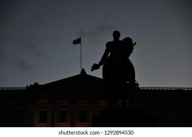 Statue of Norwegian King Karl Johan XIV in silhouette, Oslo, Norway