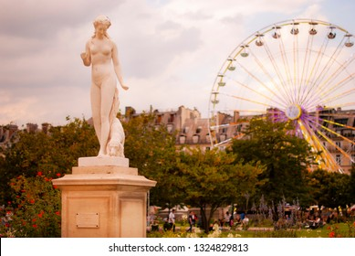 statue nymphe and ferriw whell in Tuileries garden, August, 2017. The Tuileries Garden Jardin des Tuileries is a public garden located between the Louvre Museum and the Place de la Concorde in the