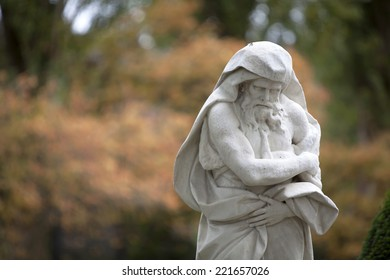 Statue of an old bearded man with a autumn background