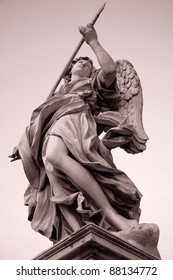 Statue on 17th Century Pont Sant Angelo Bridge by Bernini in Rome in late evening light in black and white sepia tone, Italy, Europe