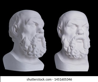Statue. On a black isolated background. Gypsum statue of Socrates head.