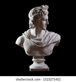 Statue. On a black isolated background. Gypsum statue of Apollo's bust. Man.