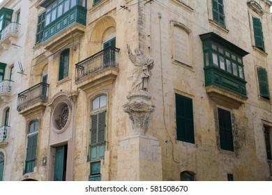 Statue on the corner of streets in the city of Senglea, Three Cities, Malta
