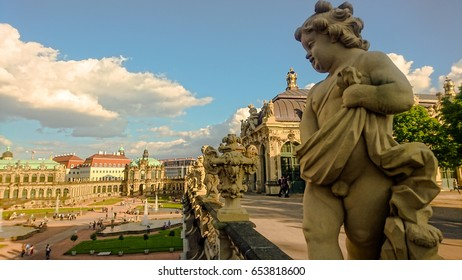 Statue on the gallery of historic Zwinger palace in Dresden, Germany