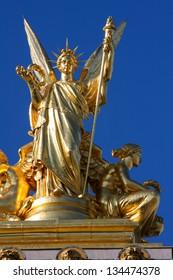 Statue on the Opera Garnier in Paris, France.