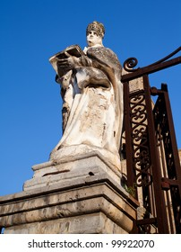 A statue on the outside of The Cathedral-Basilica of Cefalu.