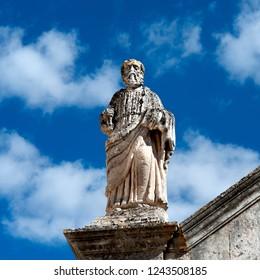 Statue on the roof of the Chiesa Madonna della Greca gothic church in the town of Locorotondo in the region of Puglia, southern Italy.