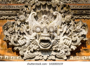 Statue on a temple entrance door in Ubud, Bali, Indonesia