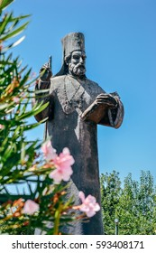 Statue of orthodox priest and flowers in Podgorica, Montenegro