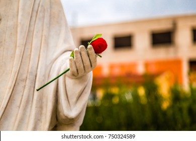 statue of Our Lady of Medjugorje, the Blessed Virgin Mary, with red rose in hand