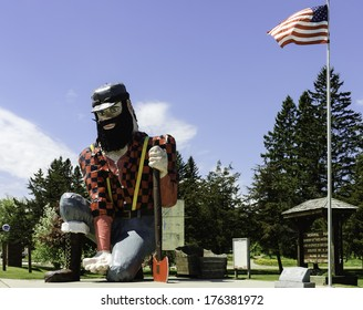 Statue of Paul Bunyan the giant lumberjack, mythical hero of the lumber camps, in memorial park on roadside of Akeley village, Minnesota, USA