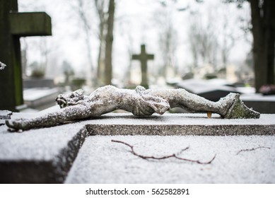 Statue in the Pere-Lachaise cemetery in Paris, in winter with snow